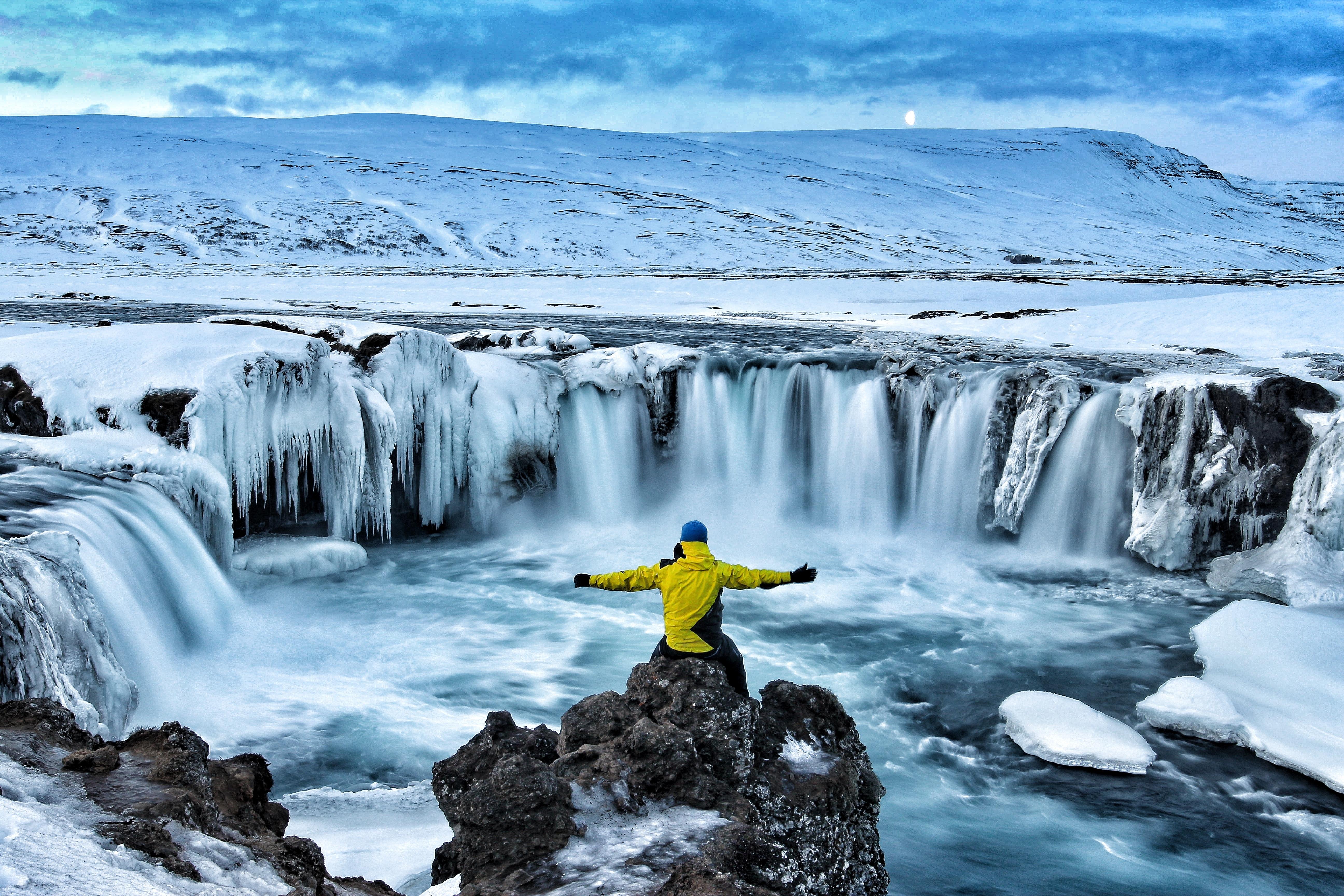 Hiker visiting Godafoss waterfall Iceland